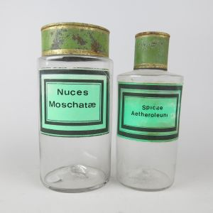 Apothecary jars with green labels
